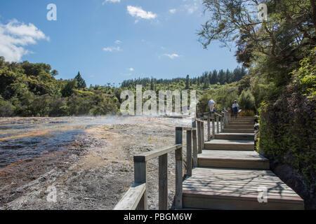 Rotorua, North Island, New Zealand-December 16,2016: Tourists exploring at the geothermal area Orakei Korako in Rotorua, New Zealand - Stock Photo
