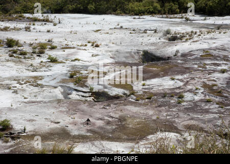 Sinter flats with crater at the Orakei Korako geothermal area in Rotorua, New Zealand - Stock Photo
