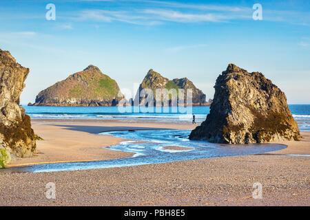 24 June 2018: Holywell, Cornwall, UK - Rocks on Holywell Beach, with a view through  to Carters Rocks, Cornwall, UK. - Stock Photo