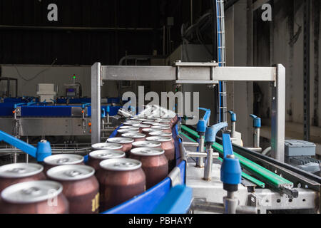 Brewery Canning Line in Action - Stock Photo