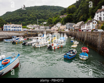 Mix of fishing and pleasure craft in the small harbour at Lynmouth, Devon, UK - Stock Photo
