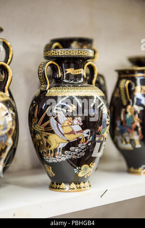 KALAMBAKA, GREECE - MAR 20, 2015: Greek vases with the traditional greek ornament. Greek vases are the popular souvenir in Greece - Stock Photo