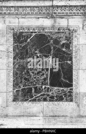 Marble insert on an old wall.