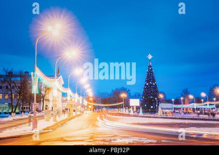 Gomel, Belarus. Main Christmas Tree And Festive Illumination On Lenin Square In Gomel. New Year In Belarus.