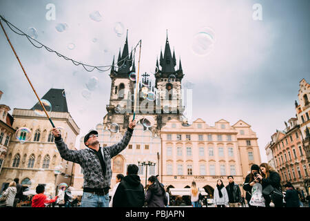 Prague, Czech Republic - September 24, 2017: Man makes soap bubbles in Old Town Square - Staromestske namesti. Church Of Our Lady Before Tyn On Backgr - Stock Photo