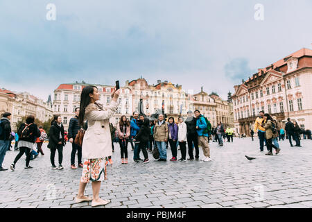 Prague, Czech Republic - September 24, 2017: Young Chinese Woman Tourist Taking Photo Of Famous Landmarks In Old Town Square - Stock Photo