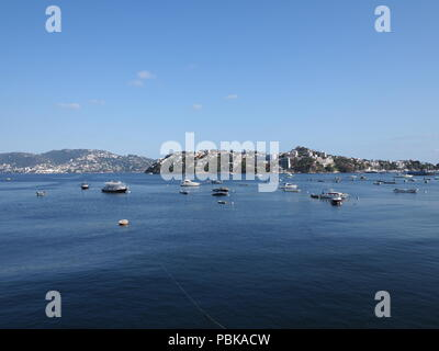 ACAPULCO, MEXICO NORTH AMERICA on MARCH 2018: Fabulous view of fishing and motor boats at bay of mexican city and landscapes of Pacific Ocean with cle - Stock Photo