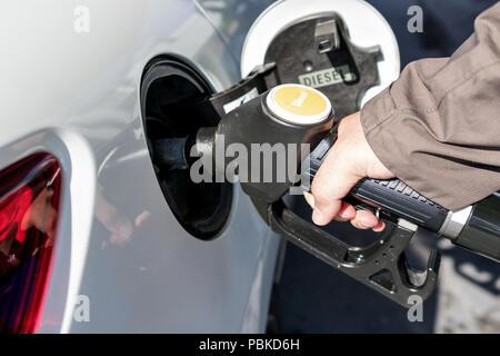 car refueling diesel pump at petrol station - Stock Photo