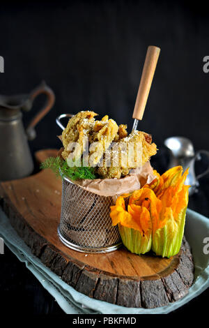 Flowers of pumpkin and zucchini fried, Traditional Italian cuisine. Copy space - Stock Photo