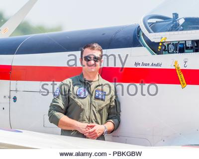 New markings pilots name applied on Croatian aerobatic group Krila oluje Wings of storm pilot posing - Stock Photo