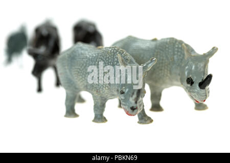 Toy rhinoceros from a vintage Noah's Ark play set, photographed on a white background. - Stock Photo
