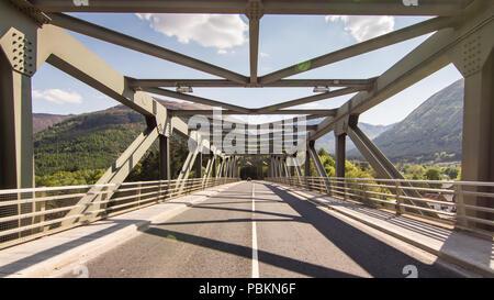 The Ballachulish steel truss bridge carrying the A82 trunk road across Loch Leven sea loch near Glen Coe in the West Highlands of Scotland. - Stock Photo