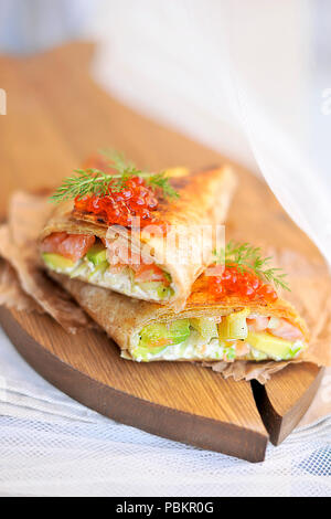 roll of bread with fish and caviar, delicious seafood. Asian cuisine. Copy space - Stock Photo
