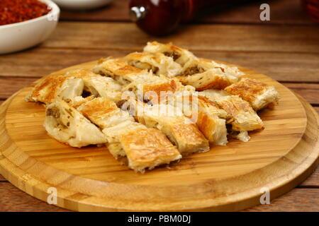 Freshly baked Turkish borek pastry rolls - Stock Photo