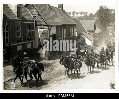 801 Indian cavalry marching through a French village near Fenges (Photo 24-212) - Stock Photo