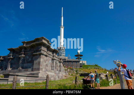 Gallo-Roman temple of Mercury with TV transmitter and observatory behind on the summit of Puy de Dome, Regional natural park of Auvergne Volcanoes, Un - Stock Photo
