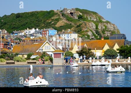 The seafront at Hastings old town area on a hot summer's day east Sussex England UK - Stock Photo