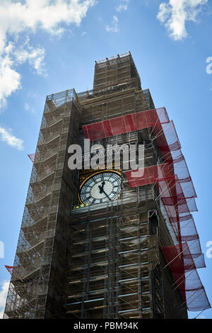 London / UK - 26th July 2018: The Elizabeth Tower housing Big Ben, part of the Houses of Parliament in London, undergoing repair - Stock Photo