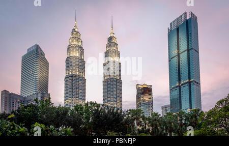 Petronas Towers in downtown Kuala Lumpur - Stock Photo