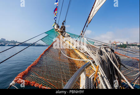 Bowsprit of sailing ship. Panorama of the seaport on the background. Concept of sea adventure, seafaring. - Stock Photo
