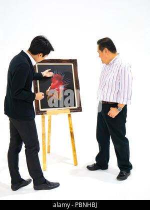 Two man talking about betta fish photo,setting on easel, in art exhibition, top view angle - Stock Photo