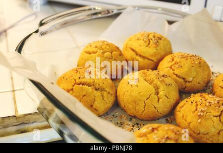 Sweet potato and pumpkin bread rolls freshly baked in a pyrex dish - Stock Photo