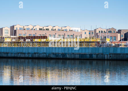 Waterfront development. Construction site next to the River Trent for new housing and apartments, Trent Basin, Nottingham, Englend, UK - Stock Photo