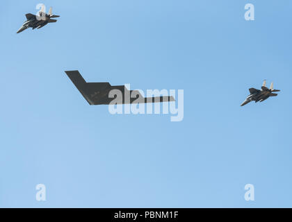 The Spirit of New York Northrop B-2 Stealth Bomber escorted by 2 RAF F-15 eagle fighter jets does a flyover display at RIAT Fairford 2018, UK. - Stock Photo