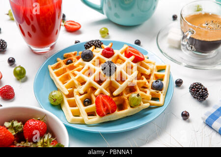 Photo of Viennese wafers, compote, coffee, raspberries, strawberries, gooseberries, cherries - Stock Photo