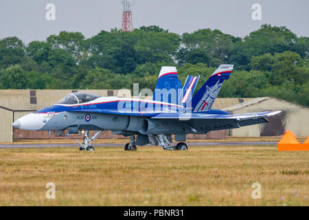 RCAF CF-18 Hornet landing after display at the Royal International Air Tattoo, RAF Fairford, UK on the 13th July 2018. - Stock Photo