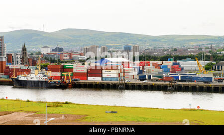 BELFAST, NI - JULY 14, 2016: Docks at the Titanic Quarter, Northern Ireland.  Belfast Harbour, known as Queen's Island until 1995 - Stock Photo