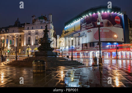 Piccadilly Circus, London-September 8,2017: Fountain in Piccadilly Circus in rainy early morning time on September 8, 2017 in London, United Kingdom - Stock Photo