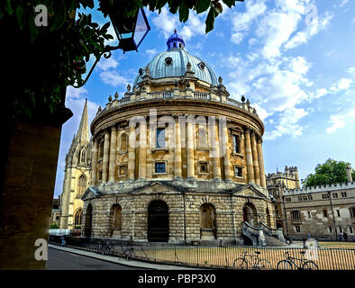 Radcliffe Camera with Brasenose College and Spire of the University Church of St Mary the Virgin in background. - Stock Photo