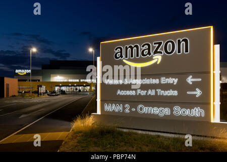 Illuminated signage at the Amazon fulfillment centre located in Warrington, UK. - Stock Photo
