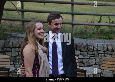 A couple posing for a photo at a wedding in Staffordshire, UK - Stock Photo