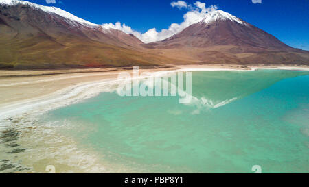 An aerial view of 'Laguna Verde' (Green Lagoon) in the way to Uyuni saltflats and amazing landscape of the Andes mountains and volcanoes, Bolivia - Stock Photo