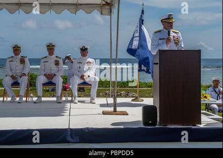 180719-N-WG252-079 ASAN BEACH, Guam (July 19, 2018) Rear Adm. Troy McClelland, Deputy Commander for the Naval Construction Force, Navy Expeditionary Command, speaks during 30th Naval Construction Regiment's (30 NCR) change of command ceremony at the War in the Pacific National Historical Park Asan Beach Unit. During the ceremony, Capt. Steven Stasick relieved Capt. Jeffrey Kilian as commodore of 30 NCR. (U.S. Navy photo by Chief Mass Communication Specialist Matthew R. White /released) - Stock Photo