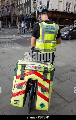 London Ambulance Paramedic cyclist on St Martins Lane, London, UK - Stock Photo