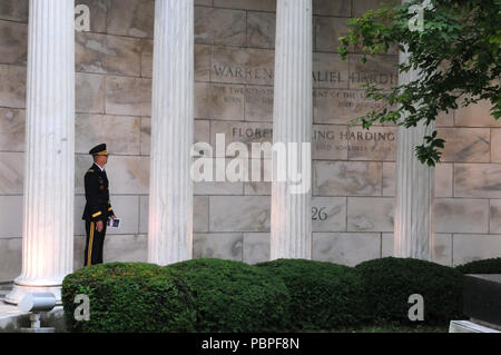 Brigadier Gen. Tony L. Wright, deputy commanding general, 88th Readiness Division, reads the inscription of the Warren G. Harding Tomb in Marion, Ohio, July 21 prior to a wreath laying ceremony honoring the 29th president of the United States. Wright served as President Donald J. Trump's representative for the annual ceremony. - Stock Photo
