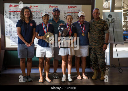Brig. Gen. Kevin J. Killea, commanding general, Marine Corps Installations-West, Marine Corps Base Camp Pendleton, stands with the top three female competitors during an award ceremony after the 2018 Armed Forces Golf Championship at Marine Memorial Golf Course, MCB Camp Pendleton, California, July 25, 2018. The winning competitors of the tournament will travel to Wardof, Germany, in September 2018, to represent their country in the 2018 International Military Sports Council golf championship. (U.S. Marine Corps photo by Lance Cpl. Noah Rudash) - Stock Photo