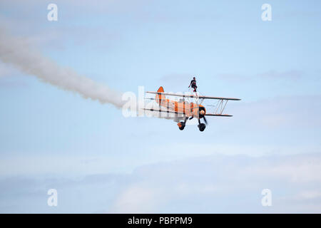 Sunderland, UK, 28 July 2018. Wingwalking during Sunderland International Airshow in Sunderland, England. The wing walker is on a plane. Credit: Stuart Forster/Alamy Live News - Stock Photo
