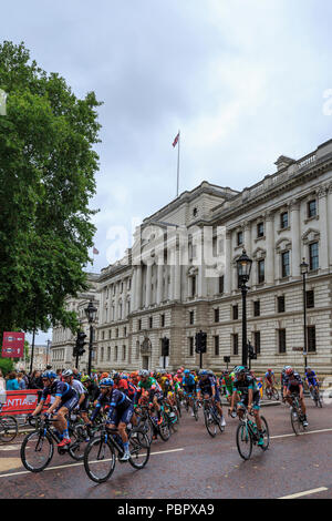 London, UK, 29 July 2018. Prudential RideLondon-Surrey Classic. The professional peloton set off from Horse Guards Parade in London for the sixth running of the 183km World Tour race, the RideLondon-Surrey Classic. The route tackles the Surrey Hills before returning to London to finish on The Mall. Credit: Clive Jones/Alamy Live News - Stock Photo