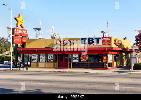 Carls Jr Carls Junior Fast Food Restaurant Sign On The Wall Of A