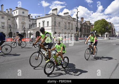 London, UK. 28th July, 2018.The Prudential RideLondon FreeCycle.  Hundreds of fans of many families in a freedom of cycling on traffic-free roads in central London. Credit: Marcin Libera/Alamy Live News - Stock Photo