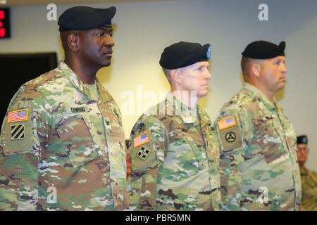 Col. Oscar W. Doward Jr., outgoing commander of the 2503rd Digital Liaison Detachment, Maj. Gen. David C. Hill, deputy commanding general, U.S. Army Central, and Col. Douglas W. Mills, incoming commander of the 2503rd DLD, stand at attention during a change-of-command ceremony July 19, 2018, at Patton Hall on Shaw Air Force Base, S.C. (U.S. Army photo by Sgt. Von Marie Donato) - Stock Photo
