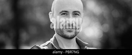 guy is smiling. Monochrome portrait of a bald bearded man. Web banner. - Stock Photo