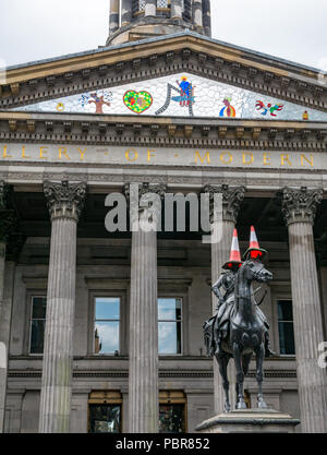 Equestrian statue Duke of Wellington with traffic cones, Gallery of Modern Art, GoMA, Royal Exchange Square, Glasgow, Scotland, UK - Stock Photo