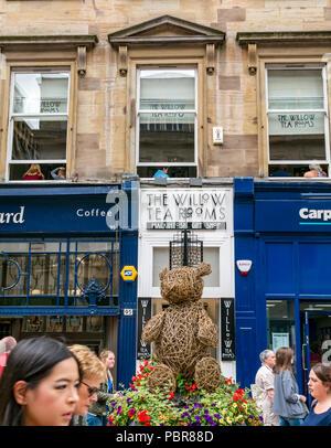 The Willow Tea Rooms Rennie Mackintosh Art Nouveau style sign, crowded Buchanan Street, Glasgow, Scotland, UK - Stock Photo