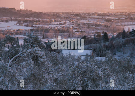 Aerial view of Foligno with snow at sunset - Stock Photo