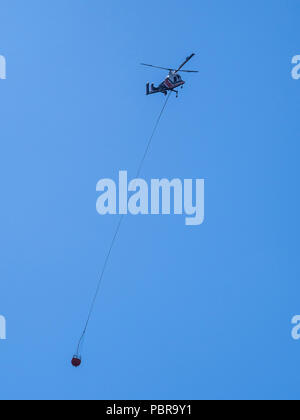 Fire-fighting helicopter over Horseshoe Lake, Mammoth Lakes, California. - Stock Photo